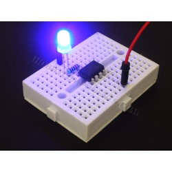 Atmel ATTiny85 in DIP package shown here with breadboard, cable and LED (which can be purchased separately).